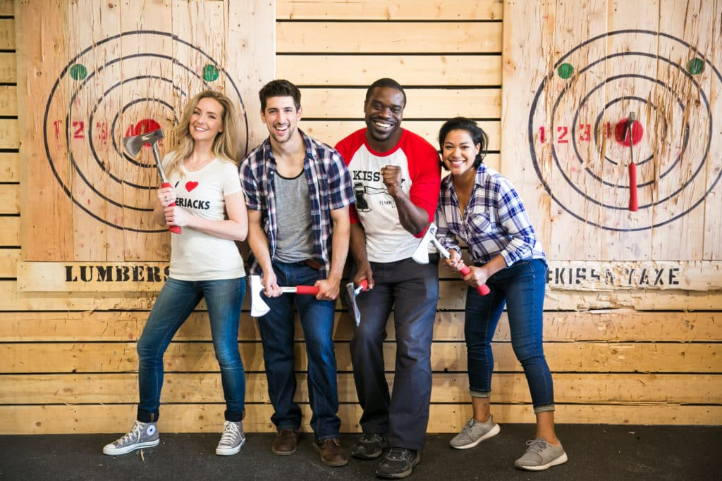 Group posing for axe throwing experience photo
